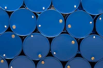 Steel Barrels - blue color - stacked on their side